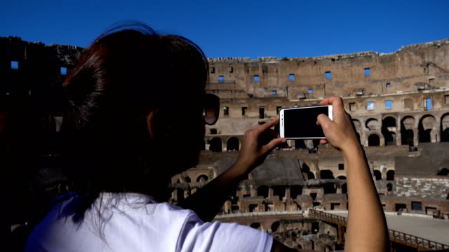 Tourist takes pictures inside the Colosseum, Rome, Italy video