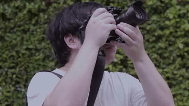 tourist taking photo video