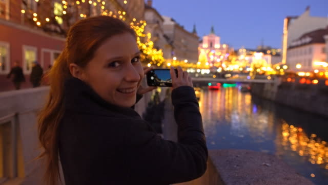 Tourist taking pictures of Ljubljana at christmas time video