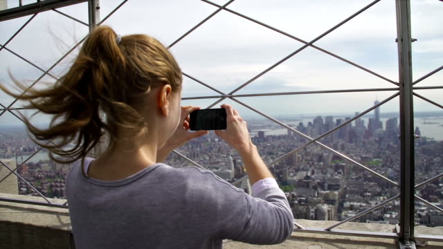 Tourist taking pictures of Manhattan NYC video
