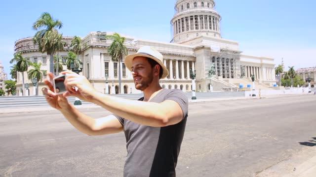 Tourist taking selfie photos in downtown of Havana, Cuba
