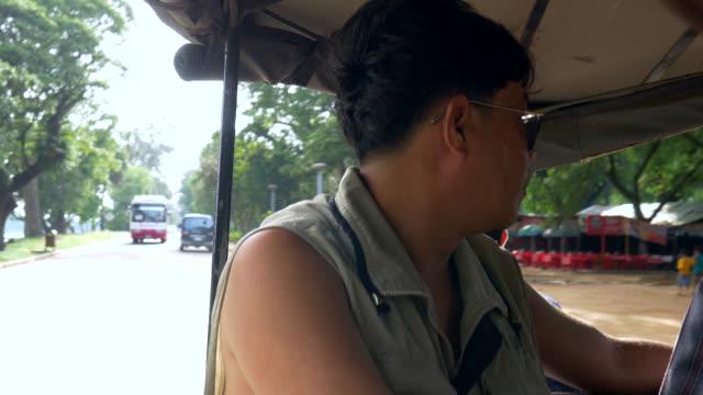 Tourist tuk-tuk in Angkor Wat temple