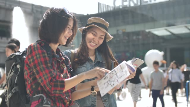 Tourist using Map in Guide Book with friend in the city Tourist using Map in Guide Book with friend guidance stock videos & royalty-free footage