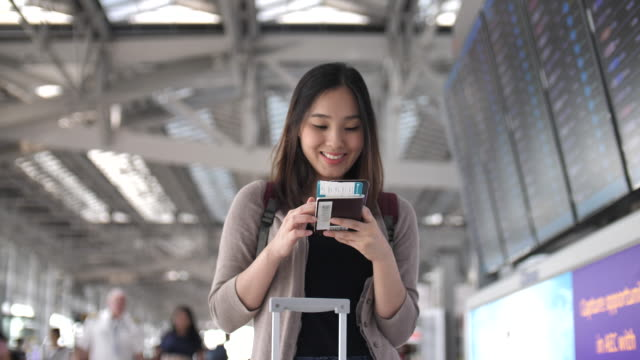 Tourist using phone for Check in online at airport video