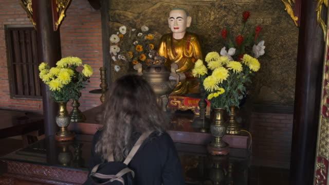 Tourist visiting Buddhist temple