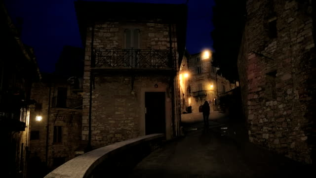 Tourist visiting medieval city by night video