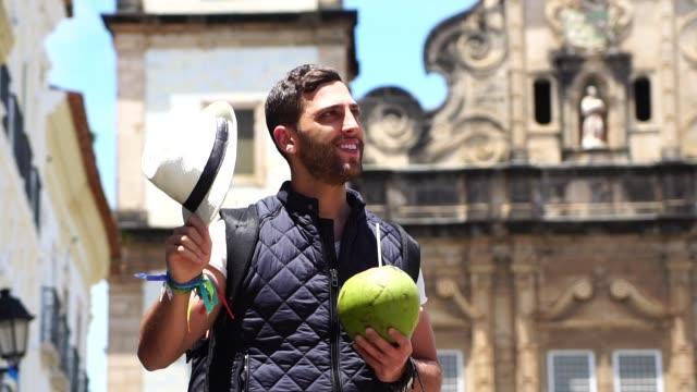 Tourist walking with coconut in Pelourinho, Bahia, Salvador, Brazil video