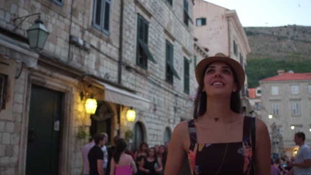 Tourist woman walking and discovering the Dubrovnik Old Town, Croatia