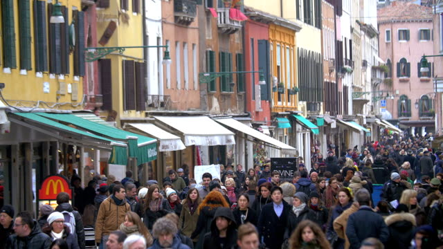 Tourists and citizens in busy Venetian street video