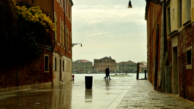Tourists and locals people walking by the venetian street after the heavy rain in Venice, Italy video