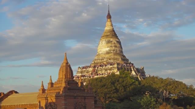 Tourists are greeted sunset at Shwesandaw Pagoda Tourists are greeted sunset at the Shwesandaw Pagoda (Paya) in Bagan, Myanmar (Burma) 4k bagan stock videos & royalty-free footage