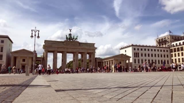 tourists at brandenburger tor, berlin in the summer