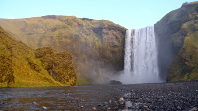 DS Tourists at Skogafoss waterfall in Iceland video