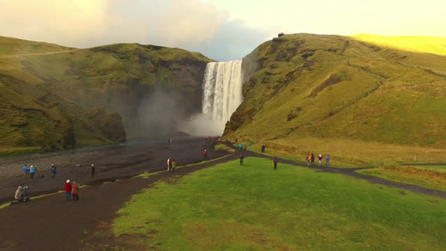 AERIAL Tourists at Skogafoss waterfall in Iceland video