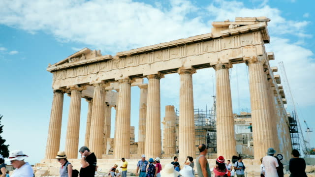 tourists chatting and strolling in front of an ancient greek temple video