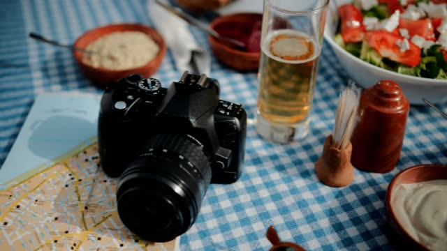 Tourists eating Mediterranean food at traditional Greek restaurant video