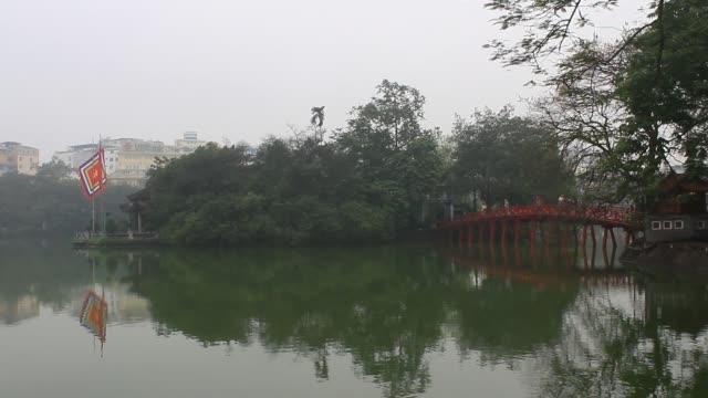 tourists on Red Bridge in Hoan Kiem Lake