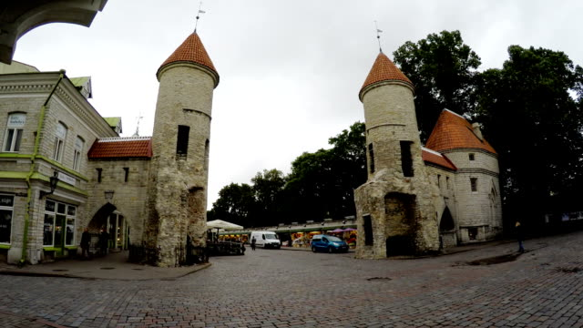tourists on the entrance from the Viru Gate of the Old city in Tallinn, Estonia video
