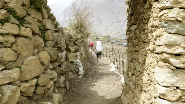 tourists on the trek around mountain manaslu, near village prok, nepal. - mustang video stock e b–roll