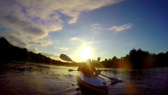 Tourists paddling boat at sunset, teamwork, active rest slowmo video