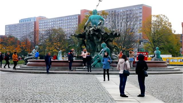 Berlin - November 2017: Tourists strolling along Alexanderplatz near the monument to Neptune video