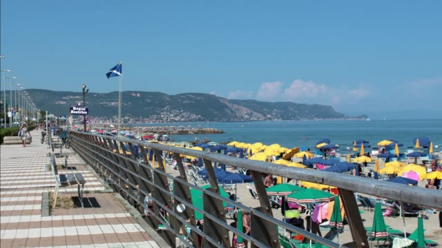 Loano, Italy - summer 2020: tourists take a walk on the promenade in the time of the covid19