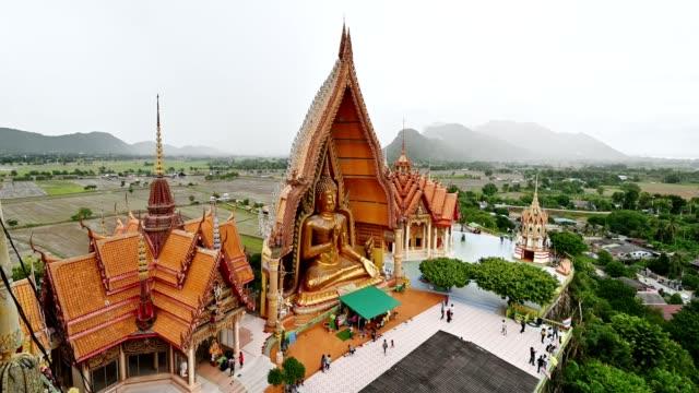 Tourists to worship the big buddha statue on hill at Wat Tham Sua