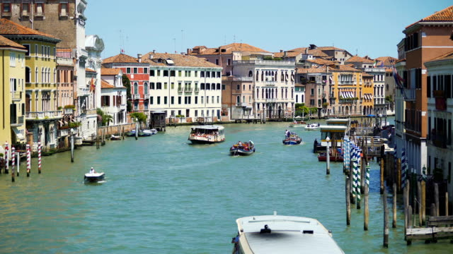 Tourists travel by vaporettos in Venice, beautiful view of Grand Canal, Italy video