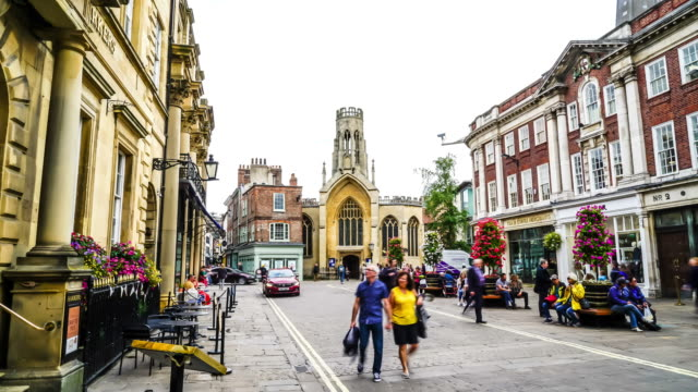 Tourists visiting and shopping in Stonegate street.