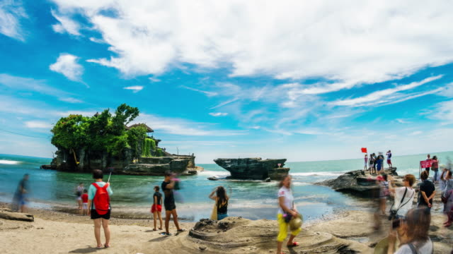 Tourists visiting Tanah Lot temple Bali Indonesia time lapse video