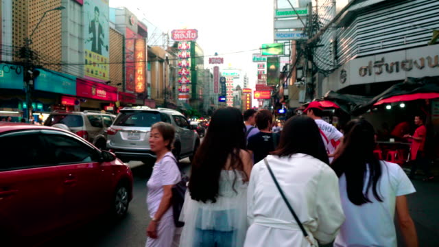 Tourists walk on the shopping street of Chinatown district, a popular tourist destination in Thailand.