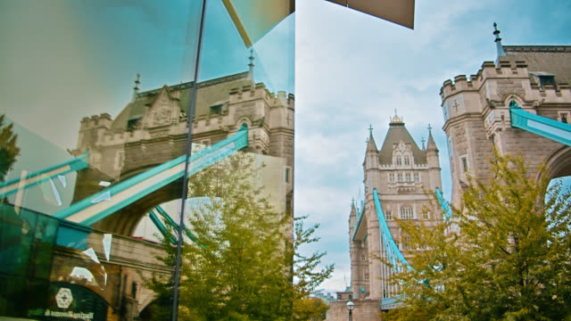 Tower Bridge. Reflection. Office building wall. Tree. London conceptual symboal