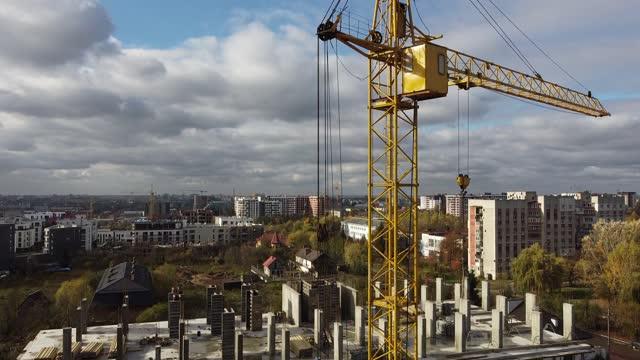 Tower crane on construction plant. Building construction. video