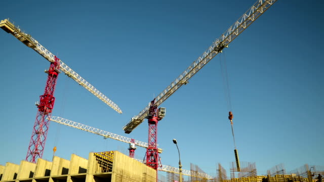 Tower cranes on construction. video
