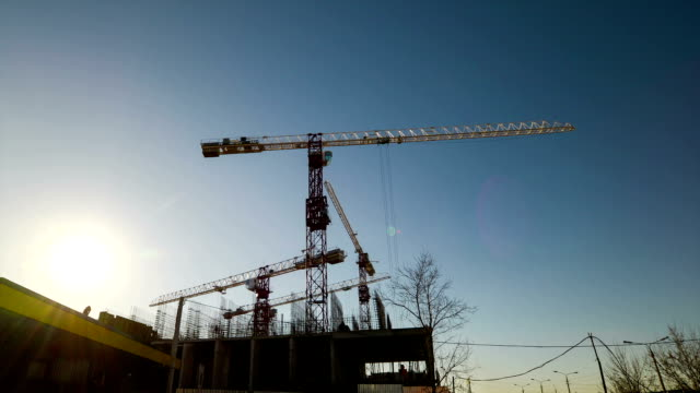 Tower cranes on construction video