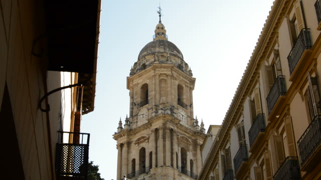 Tower of Malaga Cathedral, in Spain, between two streets. video
