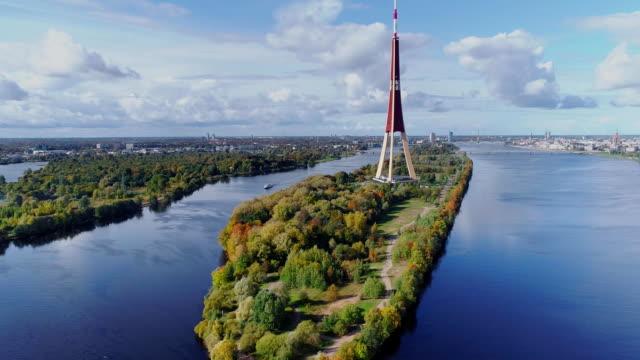 tv tower riga city drone flight, zakusala island, dugava river clouds - lettonia video stock e b–roll