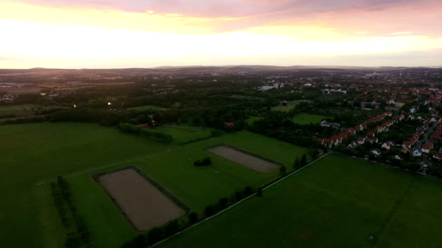 Town and Patchwork Fields Aerial During Late Afternoon video