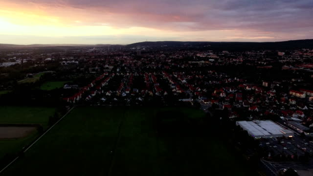 Town and Patchwork Fields Aerial During Sundown video