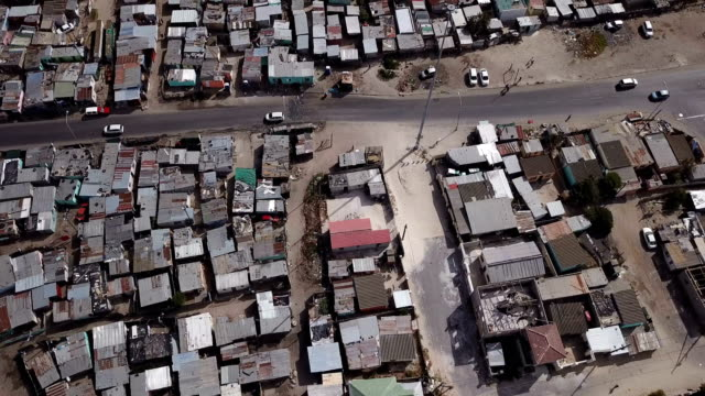 Township slum in Cape Town Township slum in Cape Town seen from drone flying above western cape province stock videos & royalty-free footage