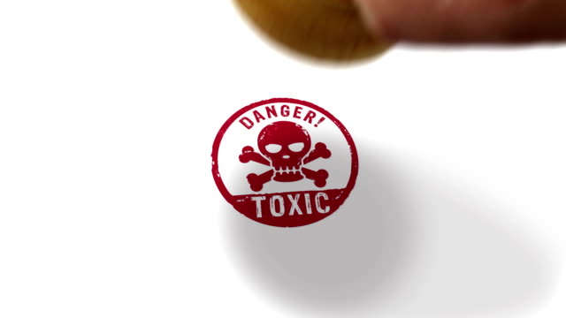 Toxic danger with skull stamp and stamping isolated animation Toxic danger with skull stamp and hand stamping impact isolated animation. Poison warning 3D rendered concept. Alpha matte channel. poisonous stock videos & royalty-free footage