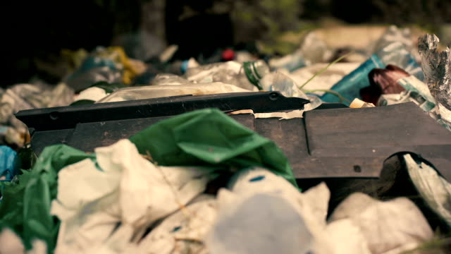 Toxic garbage lying on the ground, problems of recycling, environmental concerns video