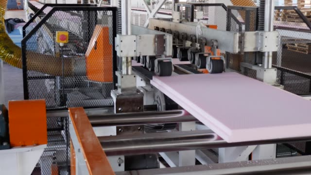 toxic substances in industry, mechanical processing styrofoam on conveyor line on plant - poliuretano polimero video stock e b–roll