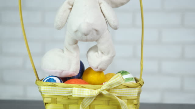 Toy bunny with goat Easter eggs.