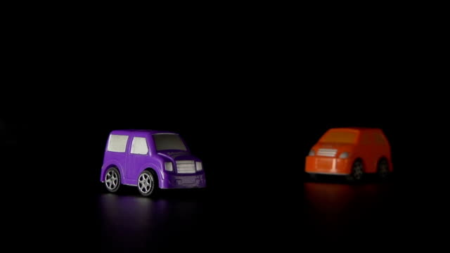 SLOW: A toy car bumps into other toy car video
