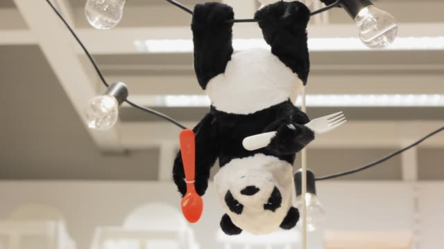 toy Panda hanging upside down a lamp for the nursery