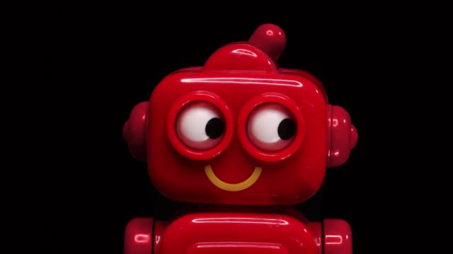 toy robot stop motion animation loop / gif di occhi che guardano avanti e indietro - giocattolo video stock e b–roll