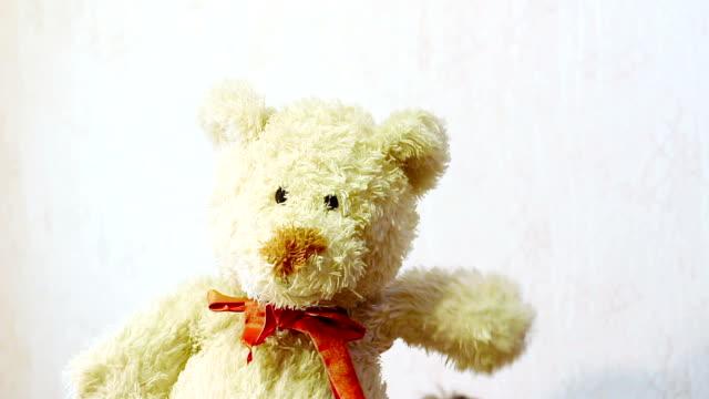 toy teddy bear waving his paw