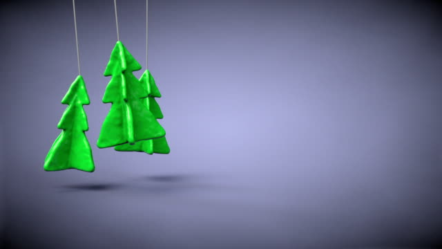 Toys of Christmas trees on ropes. video