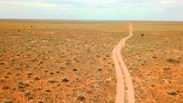 Track across the Nullarbor Plain, Australia Lonely track across the Australian desert. eternity stock videos & royalty-free footage